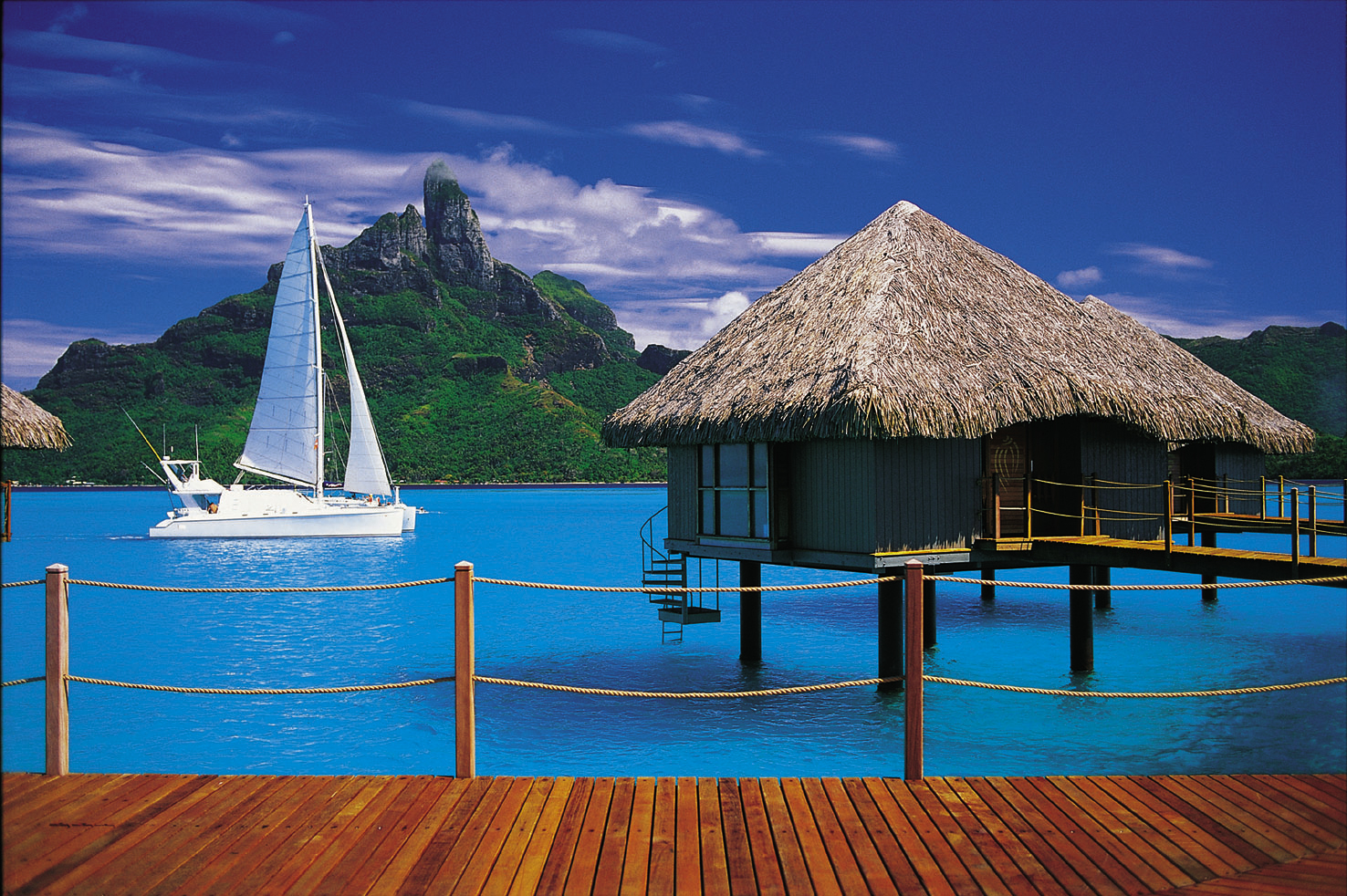 Cayo espanto belize 10 most amazing overwater bungalows for Honeymoon huts over water